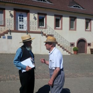 Sam Stoltzfus talking with Peter Showalter at the Ringweilerhof of Nicholas Stoltzfus.
