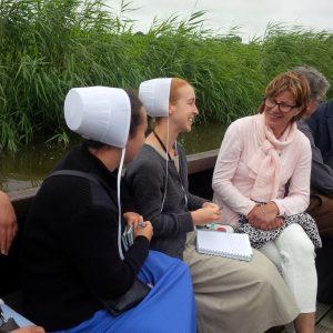 Two school teachers talking with Dutch host