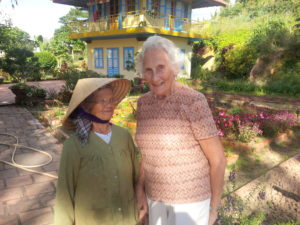 Ruth Martin talking to 83 year old at Cao Dai Temple