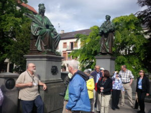 Bob Kelly sharing with the group in Worms at the Reformers Monument