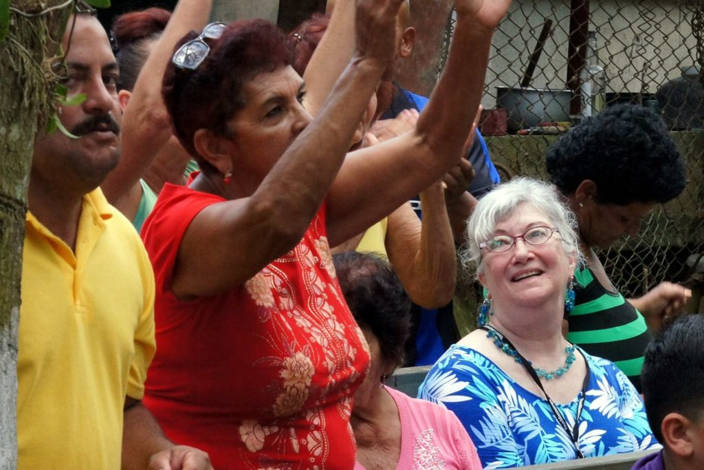 American traveler participates in worship at a church in Cuba.