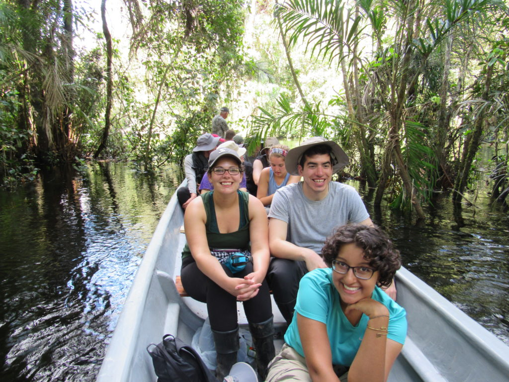 Travellers in a boat on the Aguarico River in the Amazon jungle of Ecuador.