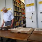 Gary showing us an early German Bible in the archive.