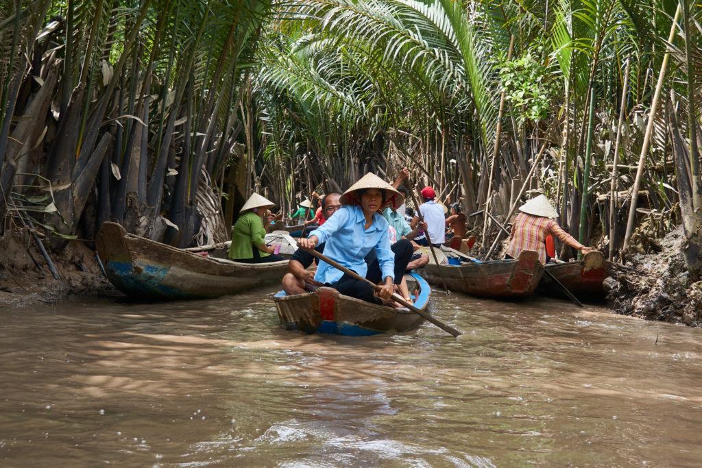 Canoers on the Mekong. Photo credit: Radek Kucharski
