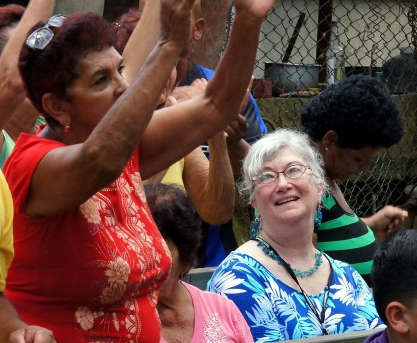 Travellers worshipping with a local church in Cuba.